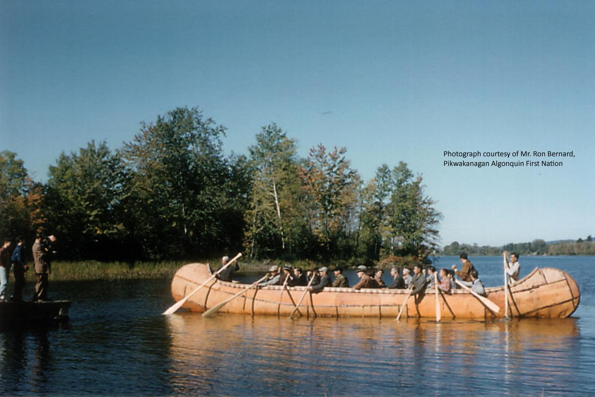 Photograph of thirty-six foot long Birch Bark Canoe built by the Algonquin Nation at Pikwanagan, Ontario, Canada