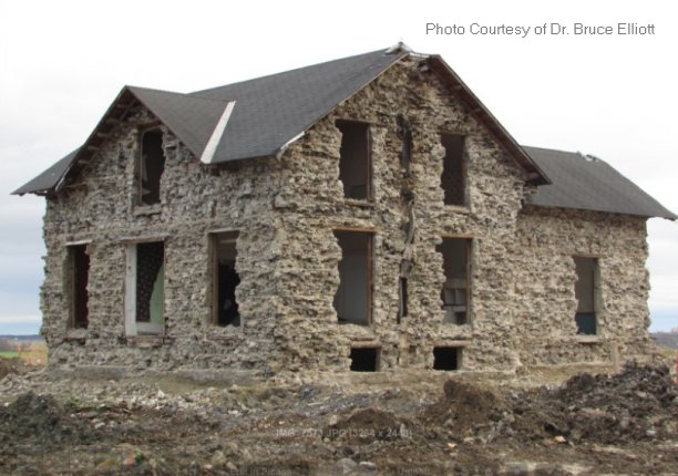 Home of Hugh Davidson family, complete outside layer of stone removed