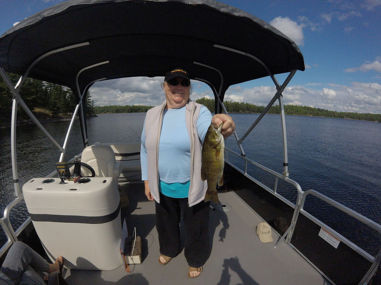 Grace with smallmouth bass, French River, Ontario, Canada