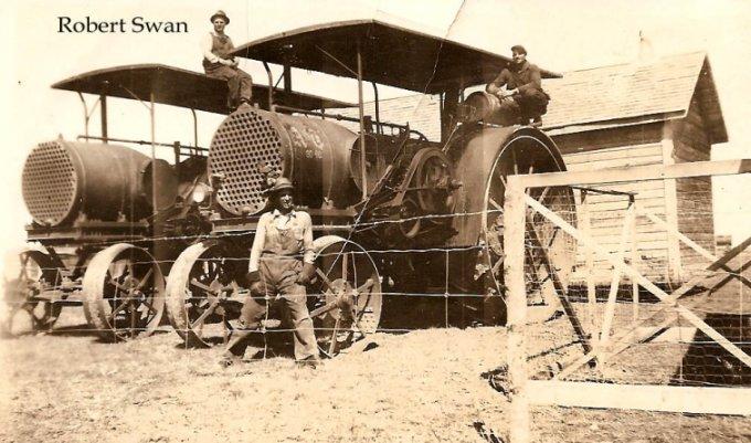 Robert Swan on Tractor in Saskatchewan
