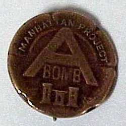 Manhattan Project A-bomb lapel pin.